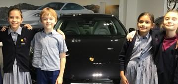 Year 5 pupils visit the Porsche Garage
